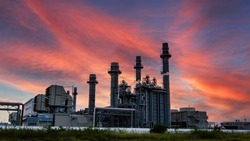 factory - petrochemical plant,oil refinery plant in a petrochemical industrial estate at dusk, with huge storage tanks chimneys throughout the factory