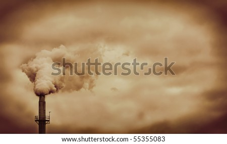 Factory pipe smoke pollution with orange sky