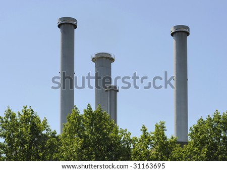 Factory pipes at a power plant producing clean air