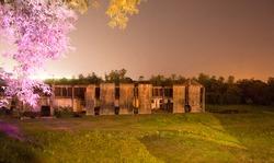 Factory ruins at night
