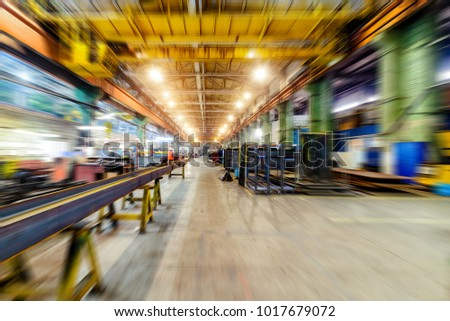 Factory shop, view from floor point. Abstract industrial background, motion blur effect. #1017679072