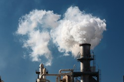 Factory smoke pipe sending smoke to the atmosphere.