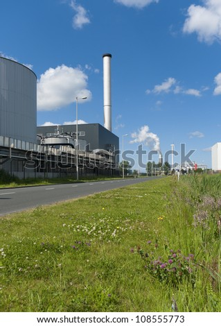 factory with large chimney in amsterdam harbor area