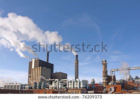 Factory with smoke on blue sky