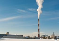 Factory with smokestack pulling out toxic steam