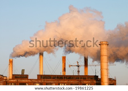Factory with smokestacks doing air pollution