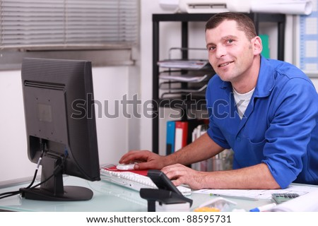 factory worker in his office