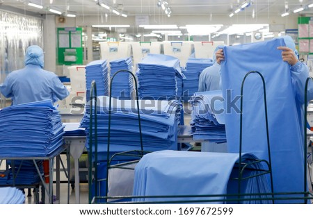 Factory workers are producing Personal Protective Equipment (PPE)for protection against viruses corona (Covid-19). For medical use.