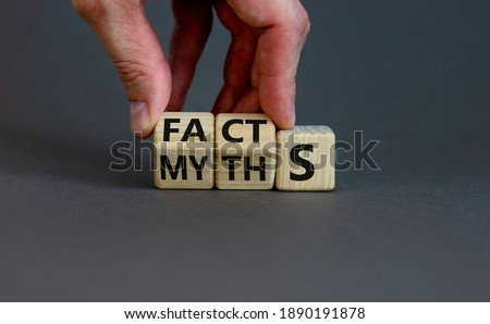 Facts or myths symbol. Businessman hand turns cubes and changes the word 'myths' to 'facts'. Beautiful grey background, copy space. Business and facts or myths concept. Photo stock ©