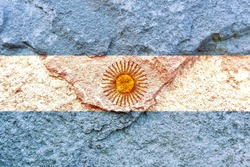 Faded Argentina national flag icon isolated on weathered rock wall background, positive Argentina political concept texture wallpaper