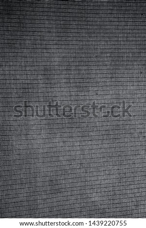 Faded charcoal Grey colored fabric texture of t-shirt with linings on it. #1439220755