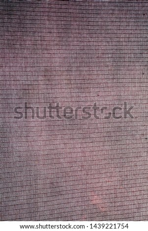 Faded charcoal Grey colored fabric texture of t-shirt with linings on it. #1439221754
