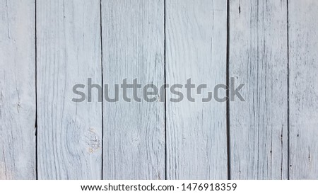 Faded grey blue paint highlighting weathered boards. #1476918359