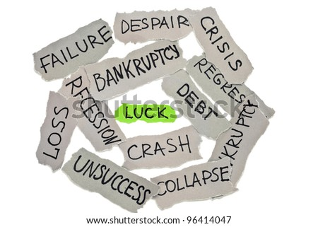 """Faded peaces of paper with ''bankruptcy'', """"loss"""", """"crisis"""", """"failure"""" etc. inscriptions surrounded green paper with """"luck"""" word. Elements on white background with shadows"""