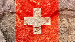 Faded Switzerland national flag icon isolated on weathered strong rock background, positive Swiss political concept texture wallpaper