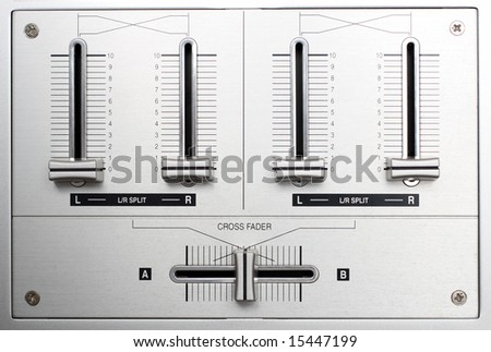 fading controls of dj music mixer closeup