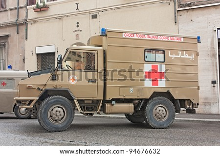 "FAENZA, ITALY - NOVEMBER 6: italian military red cross, ambulance veteran from Iraq exposed at festival ""Fiera di San Rocco"" that hosts various exposition, on November 6, 2011 in Faenza, RA, Italy"