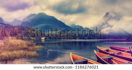 Fafantastic Asmospheric Landscape at mountain Lake. Wonderful Evening Scene with Colorful Sky and Rock Mountains on Background. Instafram Filter. Best Places for traveler Photographers