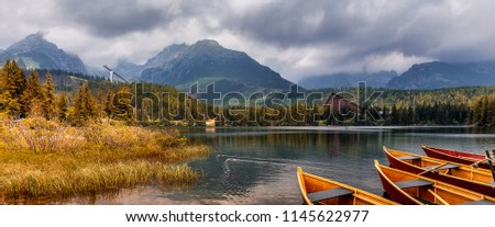 Fafantastic Panoramic view on Lake Strbske Pleso. National Park High Tatra. Slovakia. Wonderful Evening Scene with Colorful Sky and Rock Mountains on Background. Best Places for traveler Photographers