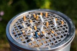 fag end on steel ashtray