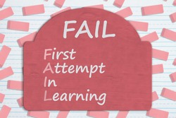 Fail first attempt in learning sign on pink eraser on ruled paper
