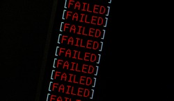 Failure concept, computer monitor display red word FAILED repeated many times, computation fatal error, program fail, software task chain failing, technology abstract, simple dark repetitive pattern