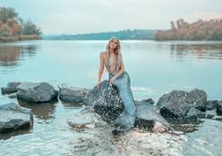 fair hair blonde real mermaid enjoy love dream  prince. Ariel queen sea image  fairy tale siren long fish tail art creative costume chic crown pearl plays sprinkle clear blue water ecology environment