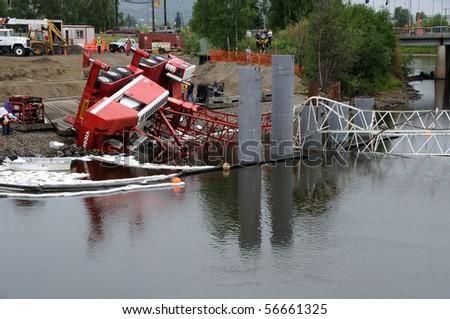 FAIRBANKS, AK - JUNE 29: Bridge construction crane topples over river  June 29, 2010 in Fairbanks, Alaska