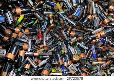FAIRFAX, VA - CIRCA 2009: Batteries lie in a heap at an undisclosed recycling center circa 2009 in Fairfax. - stock photo