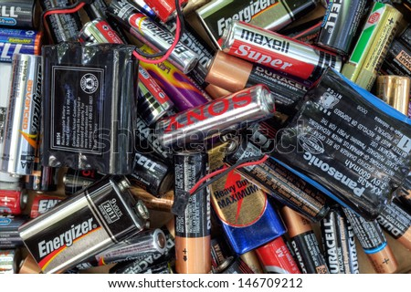 FAIRFAX, VA - JULY 16: Different types of used batteries ready for recycling lying in a heap at a recycling center on July 16, 2013 in Fairfax, VA. Types are AAA, AA, 9-volt and cordless phones.