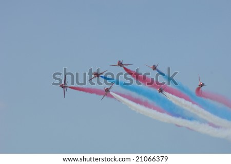 FAIRFORD, UK - JULY 16: RAF Red Arrows perform a Vixen break at the Royal International Air Tattoo on July 16, 2005 in Fairford, UK.