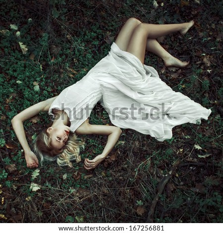 fairitale scene of a woman laying in the forest #167256881