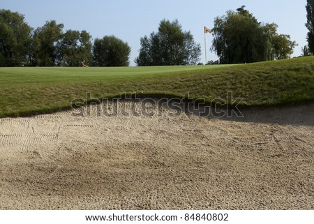 fairway of a beautiful golf course with sand bunkers