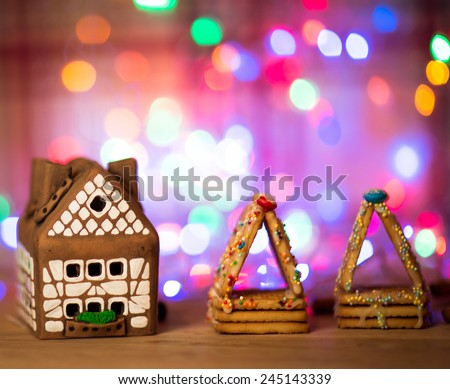 fairy Christmas house cake with candle light inside, narrow depth of field and background lights