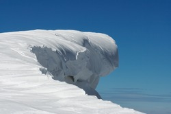 Fairy figure overhang snow cap formed on blue sky background