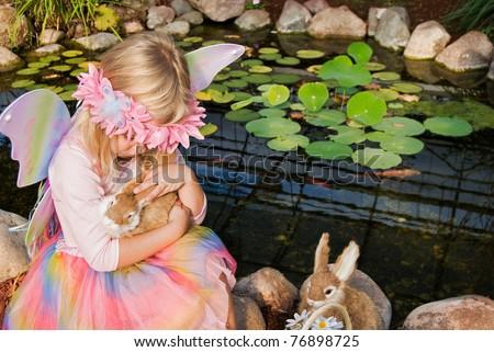 fairy girl with bunnies by koi pond