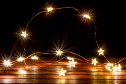 Fairy lights for christimas as illuminated decoration for christmas tree or as festive lights on the table create a romantic and festive atmosphere on christmas eve and during the happy new years eve