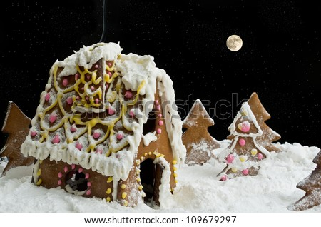 Fairy-tale christmas gingerbread house under starry heaven at night