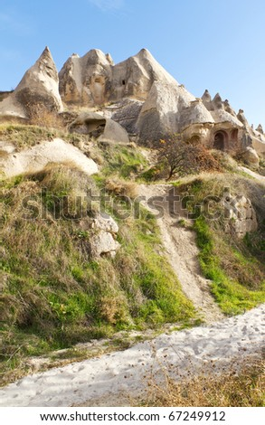 Fairy Tale Style Carved Home or Church in Swords Valley Near Goreme in Cappadocia, Anatolia, Turkey