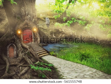 Fairy tree house in fantasy forest with stone road #561555748