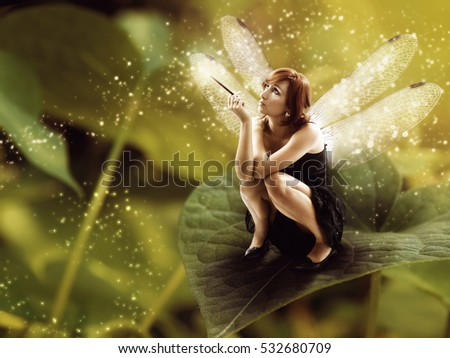 Fairy with dragonfly wings.