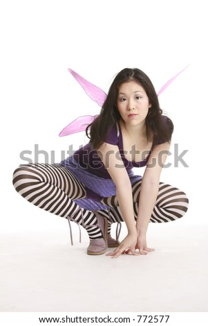 Fairy with wings crouching