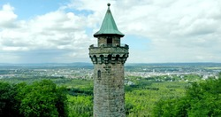 Fairytale-looking tower on top of a mountain in  the palatine forest
