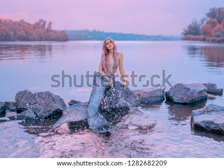 fairytale sea queen with pink long hair, jellyfish sitting on stones, dreamily looks at purple sky, mermaid splashes, sprinkles water with long, scaly tail, pastel colors, daughter of lord of oceans