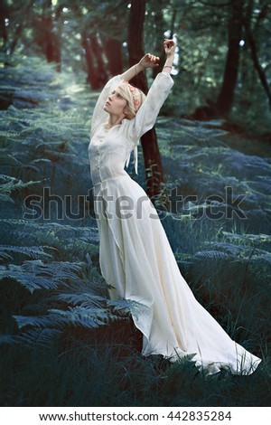 Fairytale woman dancing in magical forest. Fantasy concept #442835284