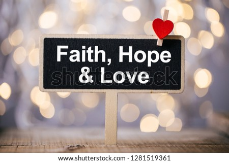 Faith Hope And Love blackboard with red heart against beautiful shiny background. #1281519361