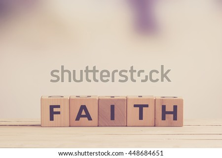 Faith sign made of wood in matte tones - Shutterstock ID 448684651