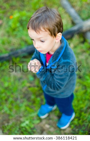 Faithful little boy praying to God in hope that he will listen to him. #386118421