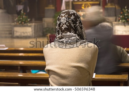Faithful woman with head lace veil during the traditional latin catholic mass Stock fotó ©