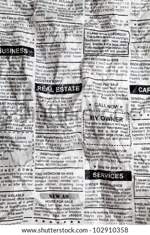 Fake Classified Ad, Crumpled; Newspaper, business concept.
